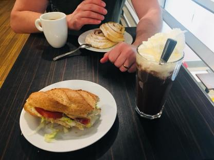 2 cinnamon pastries, one fresh sandwich and 2 beverages breakfast at Cserpes Tejivo - Budapest