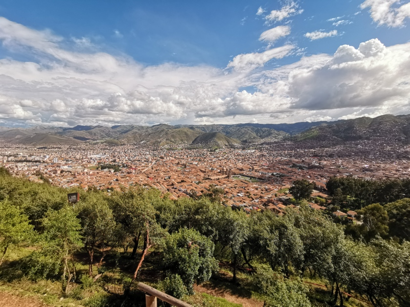 Overview of Cusco mountains and orange tile roofs